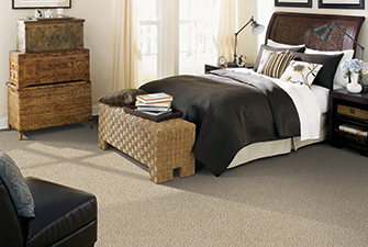 Bedroom scene with tan Softique carpet